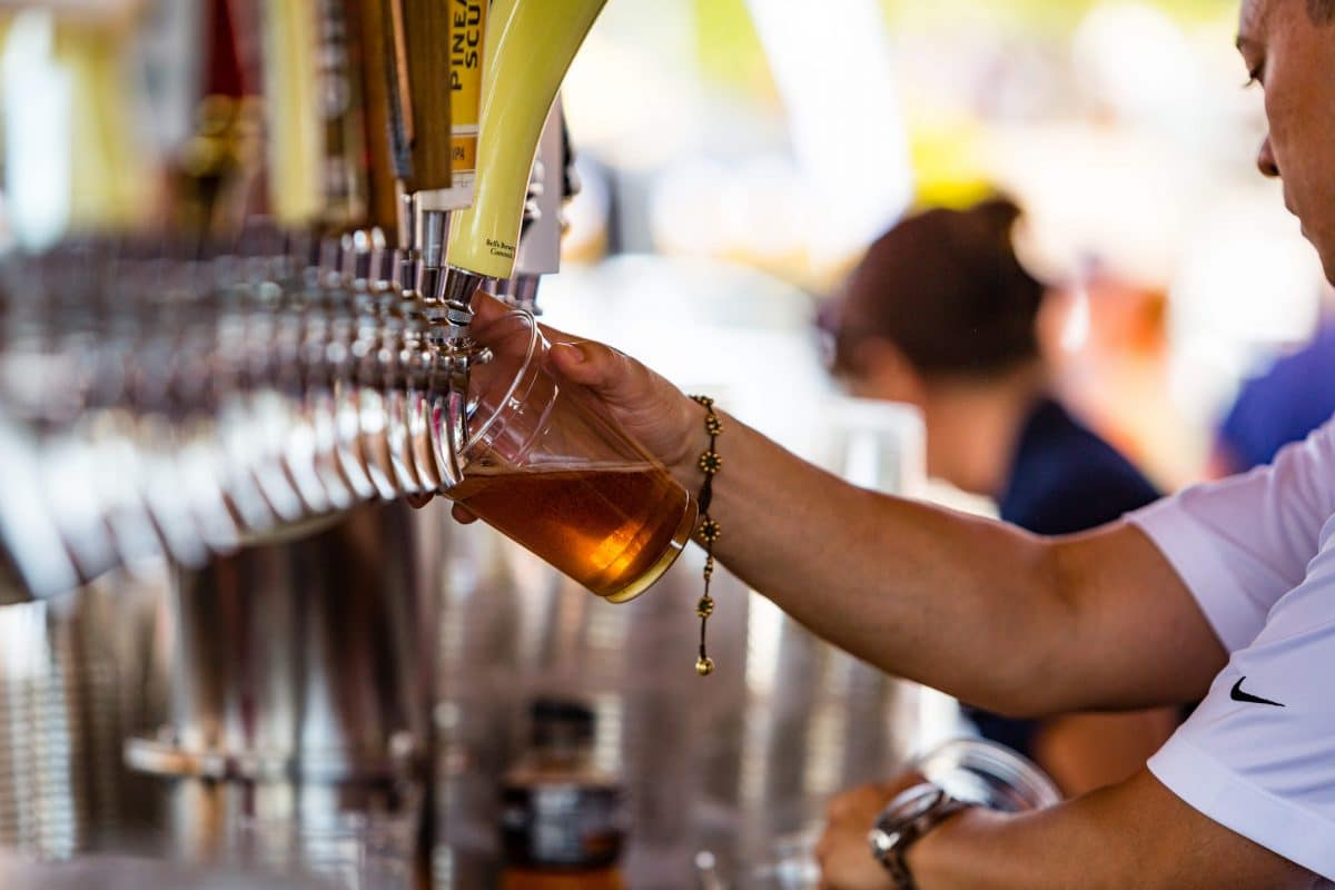 tuck_fest_employee_pouring_beer_u_s_national_whitewater_center
